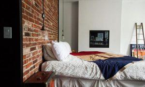 Dormitorios juveniles con paredes de piedra o ladrillo visto, estilo industrial moderno