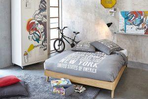 Dormitorio juveniles con paredes de hormigon moderno